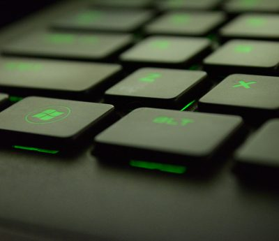Canva - Close-up Photography of Black and Green Computer Keyboard Keys